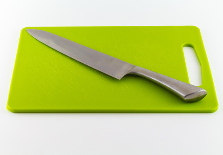 kitchen knife on cutting board isolated on white background