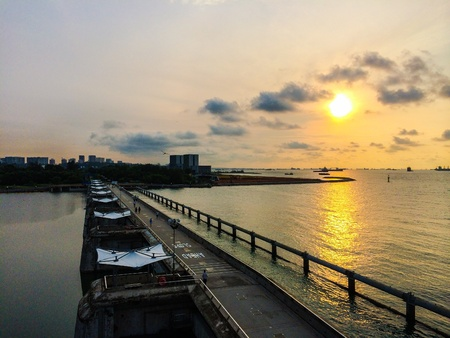 bustling: Picturesque sunrise at Marina Barrage, Singapore. Appreciating the tranquility in the morning in this bustling city! Stock Photo