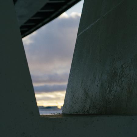 Abstract view between a frames is made of concrete coloumns.