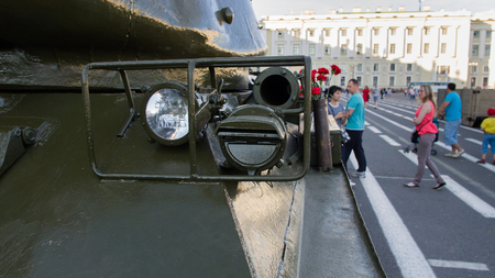 Saint-Petersburg. Russian Federation. 9 August 2017. The background is the Palace square in Day of memory and grief. The T-34 is a Soviet medium tank . A part of tank with flash light.