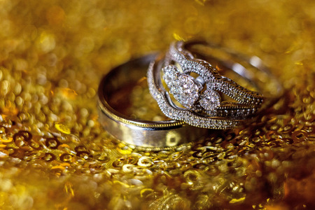 Wedding rings stacked on beautiful background 3