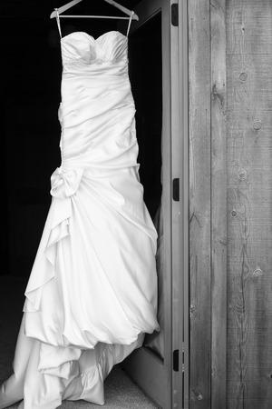 Wedding dress hanging in a doorway