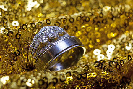 Wedding rings stacked on beautiful background 4