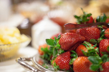 catered: Catered wedding reception with strawberries, chocolate, punch, fruit, nuts, cheese 10