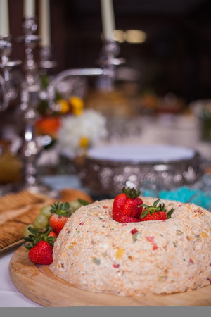 Catered wedding reception with strawberries, chocolate, punch, fruit, nuts, cheese 3 Stock Photo