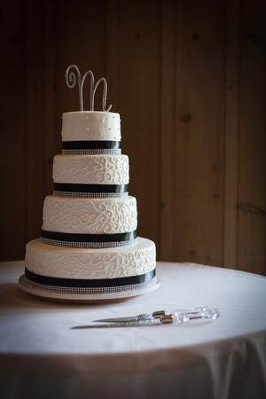 Four tiered wedding cake at a wedding reception