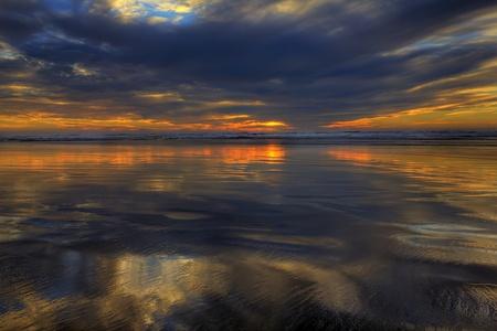 Sun setting on long beach washington during low tide