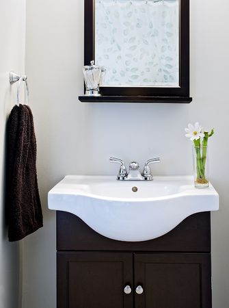 designer: Black and white designer bathroom with mirror and flower