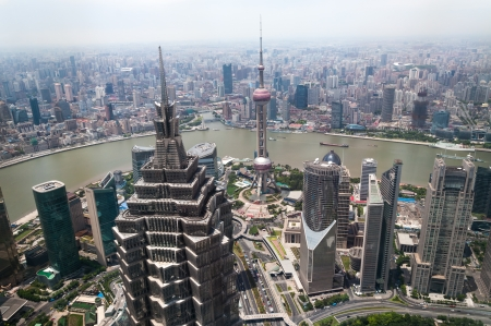 jin mao tower: The cityscape of Shanghai with the Jin Mao Tower in the foreground