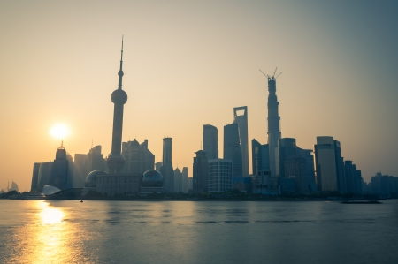 pudong district: The sun rises over the skyscrapers of Shanghai  Stock Photo