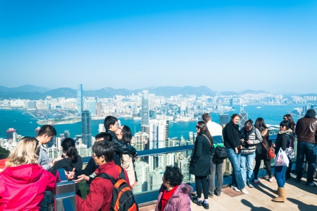 sightseers: Tourists and sightseers look out over the Hong Kong cityscape from Victoria Peak on December 31, 2012 in Hong Kong, China