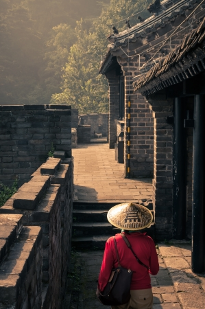 great wall: A young woman wanders along the Great Wall in China