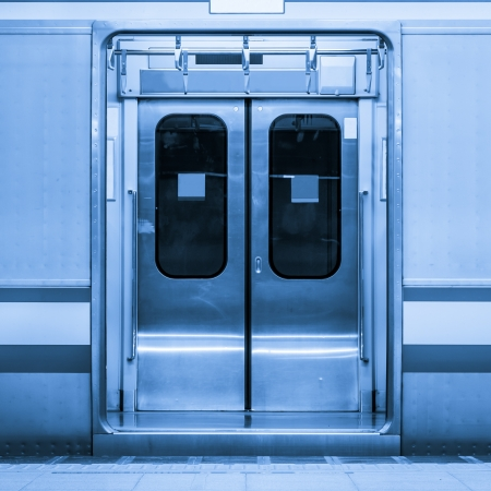 Blue toned image of public train
