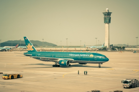 A Vietnam Airlines plane taxis along the runway, getting ready for takeoff