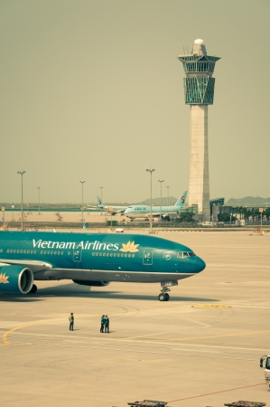 flight mode: A Vietnam Airlines plane taxis along the runway, getting ready for takeoff