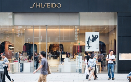 materialism: Shoppers and tourists pass by a Shiseido shop in Ginza on September 19, 2013 in Tokyo, Japan  Editorial