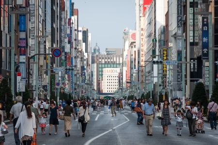 Shoppers and tourists wander around the shops and streets of Ginza on September 19, 2013 in Tokyo, Japan