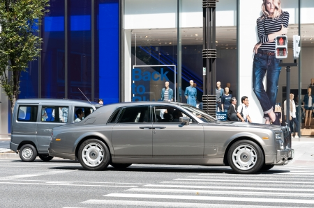 materialism: A Rolls Royce stops at a traffic light in the upscale district of Ginza in Tokyo, Japan