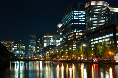The city lights of Tokyo reflect off of the water. photo
