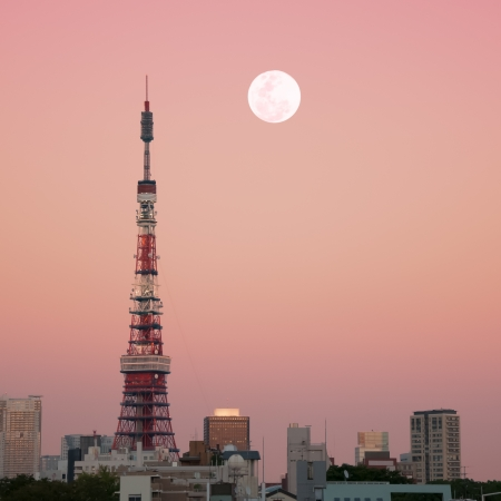 urban scenics: Tokyo Tower at dusk with the moon rising.