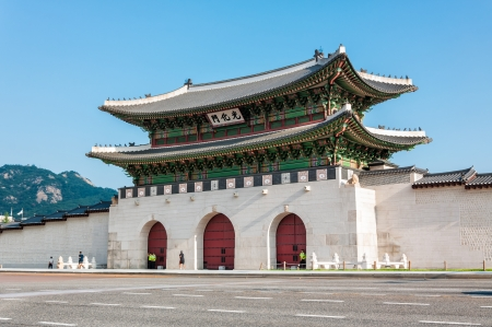main gate: Early morning joggers running past the main gate of Gyeongbokgung Palace in Seoul, South Korea  Editorial