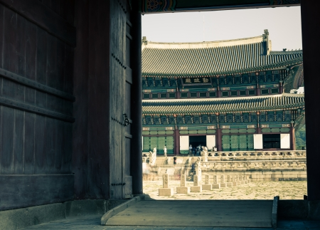Looking through an open door upon a pavilion at Gyeongbokgung Palace in Seoul, South Korea. Stock Photo - 23706160