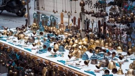 trinkets: A vendor in Insadong, Seoul, sells little brass bells and other knick knacks. Stock Photo