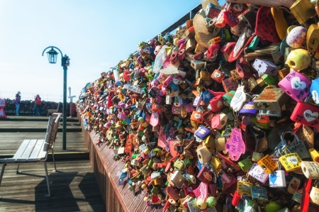 trinkets: Wall of padlocks at Namsan Tower in Seoul, South Korea. Couples write their names on the padlocks and then clip them to the fence.