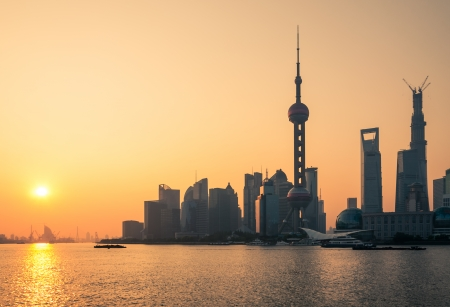 The sun rises over the skyscrapers of Shanghai