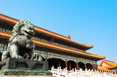 A bronze lion stands guard at the Forbidden City in Beijing, China  photo