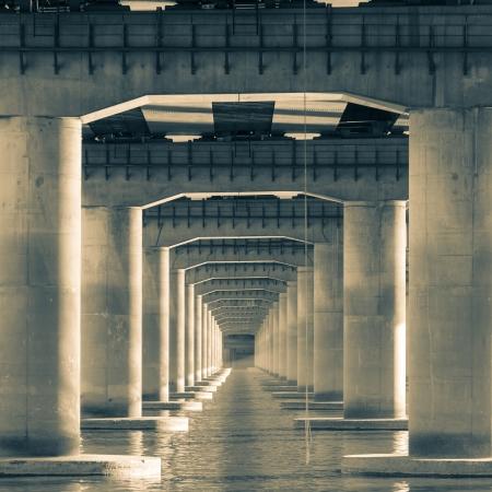 toned image: Looking through the pillars of a bridge  Toned image  Stock Photo