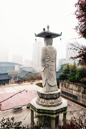 bongeunsa: The immense Buddha statue that stands among the hills at Bongeunsa Temple in Seoul, South Korea
