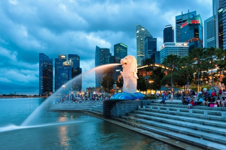 The Merlion fountain lit up at night in Singapore