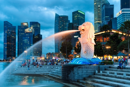 merlion: The Merlion fountain lit up at night in Singapore  Editorial