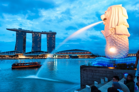 merlion: The Merlion fountain lit up at night in Singapore.
