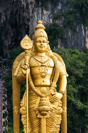 The statue of Lord Murugan that stands outside of the Batu Caves north of Kuala Lumpur, Malaysia. photo