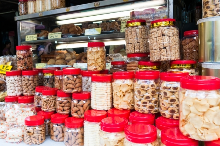 Jars of snacks are stacked outside a shop in the Chinatown district of Kuala Lumpur