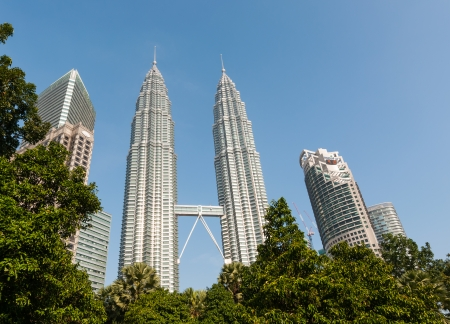 kuala lumpur tower: The bright morning sun glints off the Petronas Twin Towers and the Suria KLCC  Editorial