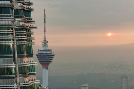 gleams: The setting sun gleams off of the second Petronas Tower and KL Tower in the distance  Photo taken December 26, 2013 in Kuala Lumpur, Malaysia  Editorial