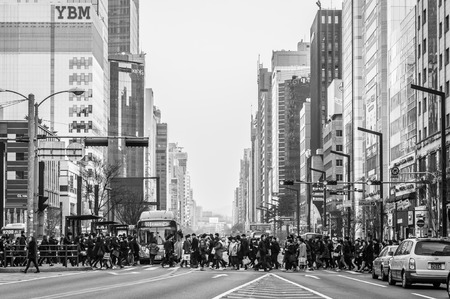 Pedestrians cross the street near Gangnam Station on February 22, 2014 in Seoul, South Korea.