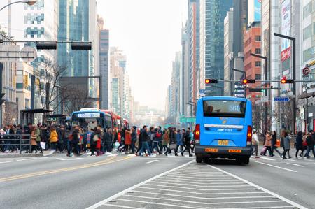 Pedestrians cross the street near Gangnam Station on February 22, 2014 in Seoul, South Korea