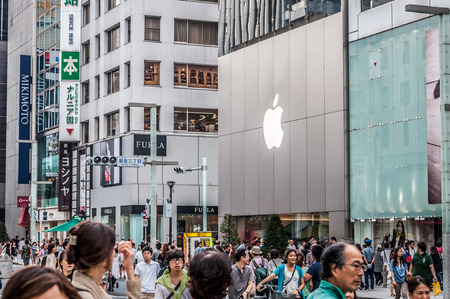 TOKYO, JAPAN - SEPTEMBER 22: Shoppers and tourists wander past a large Mac store in Ginza on September 22, 2013 in Tokyo, Japan.
