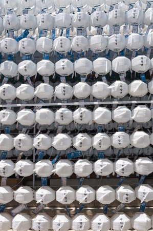 buddhas: White paper lanterns are strung up around Jogyesa Temple in honor of Buddhas Birthday on May 5, 2014 in Seoul, South Korea. Editorial