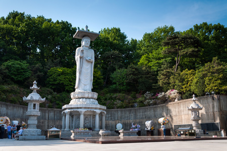 A giant Buddha statue overlooks downtown Seoul from Bongeunsa Temple