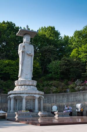 A giant Buddha statue overlooks downtown Seoul from Bongeunsa Temple  photo