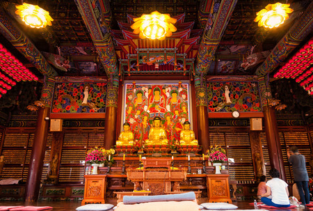 bongeunsa: Buddhists pray and meditate inside Bongeunsa Temple in Seoul, South Korea  Editorial