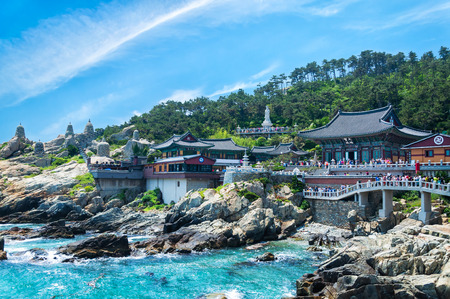Haedong Yonggungsa Temple sits upon a cliff overlooking the East Sea in Busan, South Korea  photo