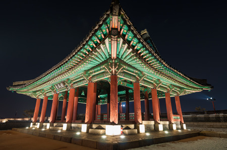 Hwaseong Fortress in Suwon, South Korea, lit up at night