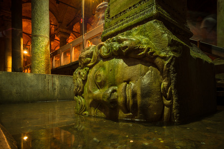 A Medusa head supports a column at the Basilica Cistern in Istanbul  Stock Photo