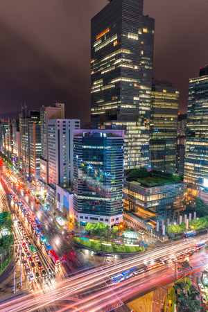 Traffic speeds through an intersection in the Gangnam district of Seoul. photo